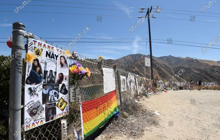 """Makeshift memorial for the late actress Naya Rivera is pictured near Lake Piru, in Los Padres National Forest, Calif., about 55 miles (90 kilometers) northwest of Los Angeles. The 33-year-old """"Glee"""" star was found dead in Lake Piru on July 13, five days after her son, Josey, was found alone on a boat the two had rented there"""