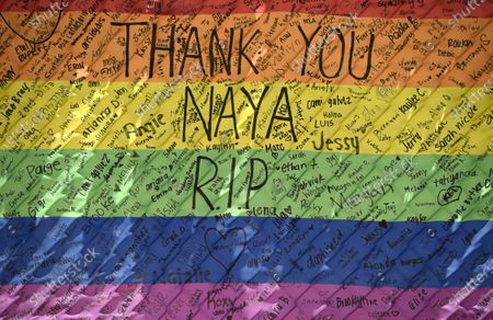 """The names of fans of the late actress Naya Rivera are written on a rainbow flag at Lake Piru, in Los Padres National Forest, Calif., about 55 miles (90 kilometers) northwest of Los Angeles. The 33-year-old """"Glee"""" star was found dead in Lake Piru on July 13, five days after her son, Josey, was found alone on a boat the two had rented there"""