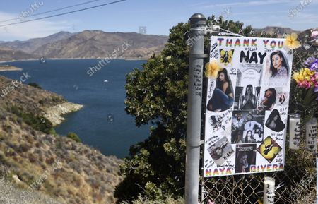 """Stock Image of Makeshift memorial for the late actress Naya Rivera is pictured at Lake Piru, in Los Padres National Forest, Calif., about 55 miles (90 kilometers) northwest of Los Angeles. The 33-year-old """"Glee"""" star was found dead in Lake Piru on July 13, five days after her son, Josey, was found alone on a boat the two had rented there"""
