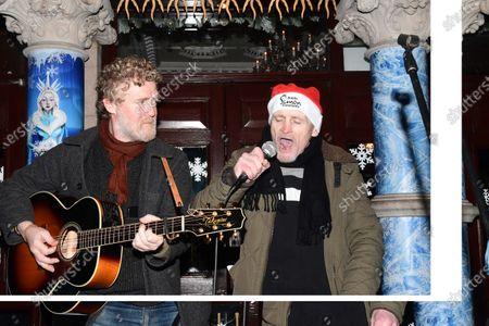 Glen Hansard and a homeless man Philip  busk on Kings Street Dublin 2 to raise money for the homeless.