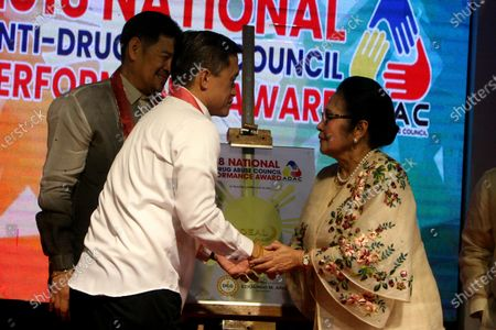 "Special Assistant to the People (SAP) Christopher Lawrence ""Bong"" Tesoro Go (left) greeted San Juan City Mayor Guia Guanzon Gomez (right) during the 2018 National Anti-Drug Abuse Council Performance Awards at Manila Hotel in the City of Manila on December 28, 2018."