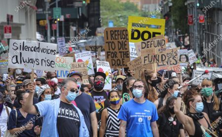 Stock Image of Coalition of teachers, students, and families protest during a rally called National Day of Resistance Against Unsafe School Reopening Opening, in New York. Organizers said New York Governor Andrew Cuomo, New York Mayor Bill DeBlasio, Chancellor Richard Carranza, and the Department of Education must stop the in-person reopening of schools until it is safe for all