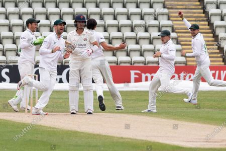 WICKET - Rob Jones is caught at short leg as Chris Wright celebrates before the Bob Willis Trophy match between Lancashire County Cricket Club and Leicestershire County Cricket Club at Blackfinch New Road, Worcester