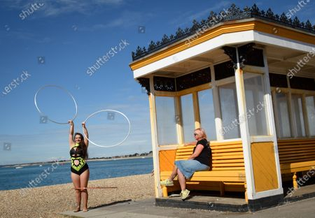 Circus Artist Carina performs on the Southsea waterfront ahead of todays show
