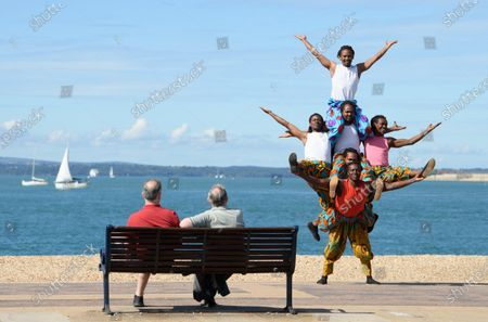The 'Timbuktu tumblers' from Kenya perform their balancing act on the Southsea waterfront