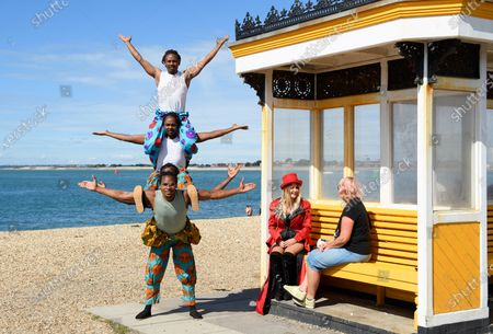 Stockbild von The 'Timbuktu tumblers' from Kenya perform their balancing act on the Southsea waterfront