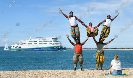 Stockabbildung von The 'Timbuktu tumblers' from Kenya perform their balancing act on the Southsea waterfront