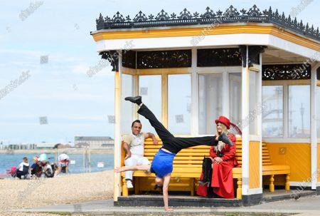 The 'Garcia Duo' perform their hand balancing act on the Southsea waterfront