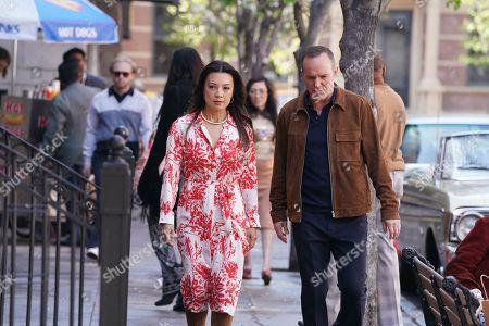 Ming-Na Wen as Melinda May and Clark Gregg as Phil Coulson