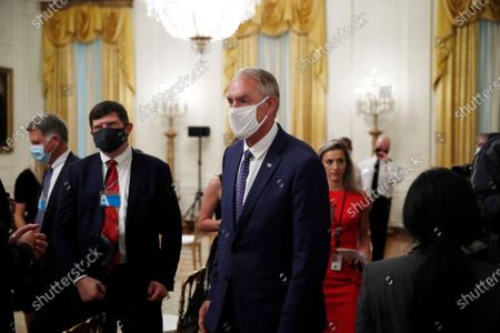 """Former Secretary of the Interior Ryan Zinke attends a signing ceremony for H.R. 1957 - """"The Great American Outdoors Act,"""" in the East Room of the White House, in Washington"""