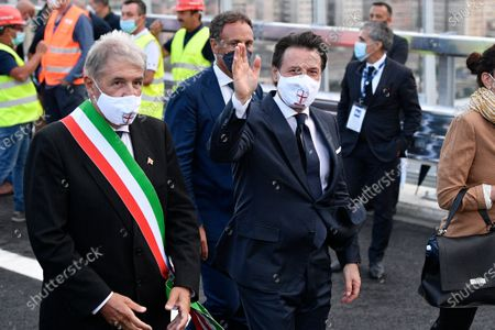 Italian Prime Minister Giuseppe Conte  (R) wearing a mask is seen leaving the official inauguration ceremony of the new San Giorgio bridge. The new San Giorgio bridge designed by architect Renzo Piano replaces Morandi bridge that collapsed in August 2018 and the new bridge is set to reopen on 05 August 2020 during the inauguration ceremony.