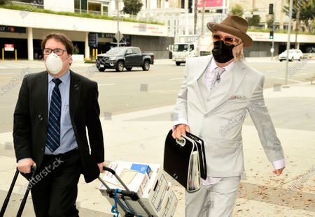 Stock Photo of Michael Lockwood, right, arrives at the Stanley Mosk Courthouse for his divorce trial with Lisa Marie Presley, in Los Angeles. Presley and Lockwood wed in 2006 and filed for divorce in 2016