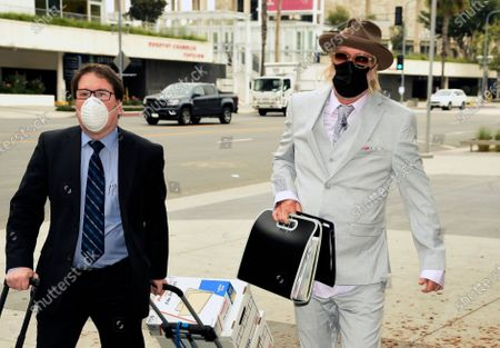 Michael Lockwood, right, arrives at the Stanley Mosk Courthouse for his divorce trial with Lisa Marie Presley, in Los Angeles. Presley and Lockwood wed in 2006 and filed for divorce in 2016