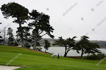 Davis Love III, right, walks on the 15th fairway during practice for the PGA Championship golf tournament at TPC Harding Park in San Francisco