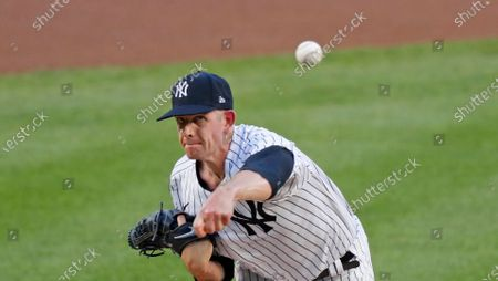New York Yankees starting pitcher James Paxton delivers during the first inning of a baseball game against the Boston Red Sox, at Yankee Stadium in New York