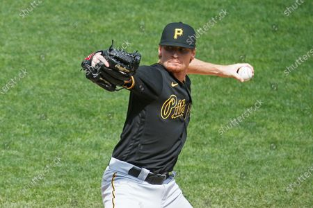 Pittsburgh Pirates pitcher Sam Howard throws against the Minnesota Twins in the fourth inning of a baseball game, in Minneapolis