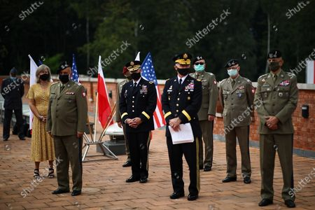 Chief of Staff of the US Ground Forces General James McConvill (4R), General Commander of the Polish Armed Forces General Jaroslaw Mika (2L) and Chief of the General Staff of the Polish Army General Rajmund T. Andrzejczak (R) during a meeting with the US Ambassador to Poland Georgette Mosbacher and Polish Defense Minister Mariusz Blaszczak in Krakow, Poland, 04 August 2020. During the meeting, the location of the forward American command structure in Poland, responsible for ensuring proper command and cooperation with American and European allies, was confirmed. Defence Minister Mariusz Blaszczak said in Krakow, southern Poland, on Tuesday that placing the forward command of the 5th US Army Corps in Poland is the crowning achievement of efforts to increase the American military presence in Poland.