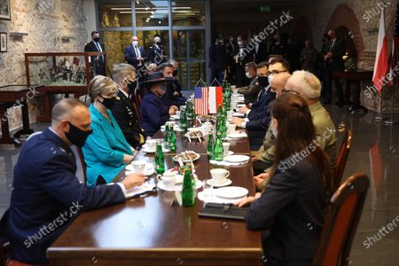 Polish Defense Minister Mariusz Blaszczak (5-R) during a meeting with the US Ambassador to Poland Georgette Mosbacher (4-L) in Krakow, Poland, 04 August 2020. During the meeting, the location of the forward American command structure in Poland, responsible for ensuring proper command and cooperation with American and European allies, was confirmed. Defence Minister Mariusz Blaszczak said in Krakow, southern Poland, on Tuesday that placing the forward command of the 5th US Army Corps in Poland is the crowning achievement of efforts to increase the American military presence in Poland.