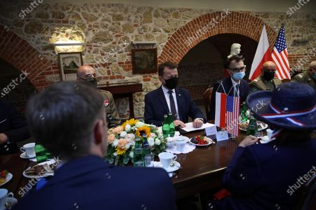 Polish Defense Minister Mariusz Blaszczak (C) during a meeting with the US Ambassador to Poland Georgette Mosbacher (R) in Krakow, Poland, 04 August 2020. During the meeting, the location of the forward American command structure in Poland, responsible for ensuring proper command and cooperation with American and European allies, was confirmed. Defence Minister Mariusz Blaszczak said in Krakow, southern Poland, on Tuesday that placing the forward command of the 5th US Army Corps in Poland is the crowning achievement of efforts to increase the American military presence in Poland.