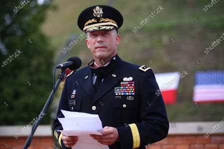 The commander of the 1st Infantry Division of the United States Ground Forces, General Jan Kolasheski, receives a nomination for the next rank of general during a meeting with the US Ambassador to Poland Georgette Mosbacher and Polish Defense Minister Mariusz Blaszczak in Krakow, Poland, 04 August 2020. During the meeting, the location of the forward American command structure in Poland, responsible for ensuring proper command and cooperation with American and European allies, was confirmed. Defence Minister Mariusz Blaszczak said in Krakow, on Tuesday that placing the forward command of the 5th US Army Corps in Poland is the crowning achievement of efforts to increase the American military presence in Poland.
