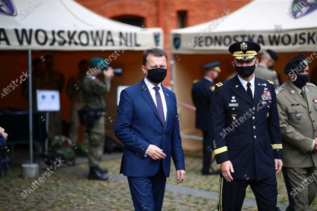 Polish Defense Minister Mariusz Blaszczak (L) and Chief of Staff of the US Ground Forces General James McConvill (C) during a meeting with the US Ambassador to Poland Georgette Mosbacher in Krakow, Poland, 04 August 2020. During the meeting, the location of the forward American command structure in Poland, responsible for ensuring proper command and cooperation with American and European allies, was confirmed. Defence Minister Mariusz Blaszczak said in Krakow, southern Poland, on Tuesday that placing the forward command of the 5th US Army Corps in Poland is the crowning achievement of efforts to increase the American military presence in Poland.