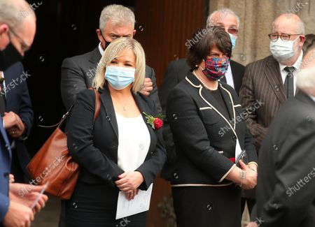 First Ministers from Northern Ireland Michelle O'Neill and Arlene Foster pictured leaving the Cathedral after the service.