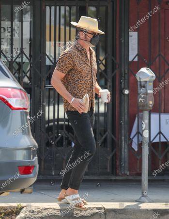 Stock Photo of Chris Pine seen grabbing Blue Bottle Coffee in Los Feliz