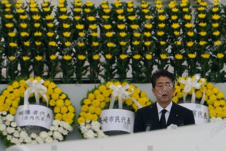 Japanese Prime Minister Shinzo Abe delivers a speech during a ceremony to mark the 75th anniversary of the bombing at the Hiroshima Peace Memorial Park, in Hiroshima, western Japan
