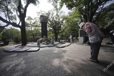 Woman prays before a memorial service for Korean atomic bomb victims in front of Monument to Korean Victims and Survivors at Hiroshima Peace Memorial Park in Hiroshima, western Japan, . Hiroshima marks the 75th anniversary of the world's first atomic bombing on Aug. 6