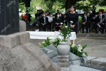 Izumi Nakamitsu, U.N. undersecretary-general and high representative for disarmament affairs, offers prays as South Korean residents living in Japan gather for a memorial service in front of the cenotaph for Korean atomic bomb victims at Hiroshima Peace Memorial Park in Hiroshima, western Japan, . Hiroshima marks the 75th anniversary of the world's first atomic bombing on Aug. 6