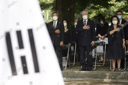 South Korean residents living in Japan offer prayers in front of the cenotaph for Korean atomic bomb victims at Hiroshima Peace Memorial Park in Hiroshima, western Japan, . Hiroshima marks the 75th anniversary of the world's first atomic bombing on Aug. 6