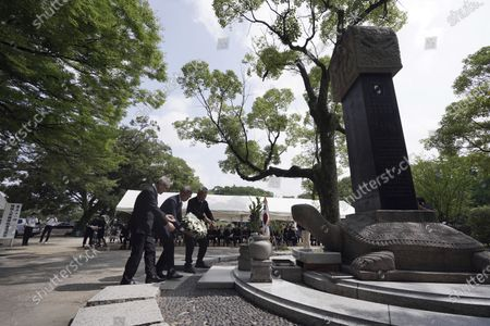 South Korean residents living in Japan offer a wreath during a memorial service for Korean atomic bomb victims in front of Monument to Korean Victims and Survivors at Hiroshima Peace Memorial Park in Hiroshima, western Japan, . Hiroshima marks the 75th anniversary of the world's first atomic bombing on Aug. 6