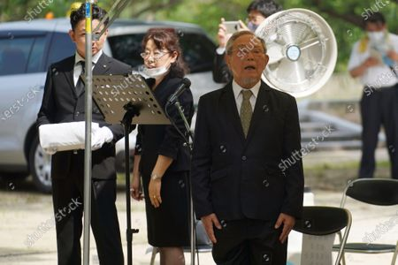 Lee Jong-keun, an atomic bombing survivor and a second-generation Korean born in Japan, attends a memorial service for Korean atomic bomb victims in front of the Monument to Korean Victims and Survivors at Hiroshima Peace Memorial Park in Hiroshima, western Japan, . Hiroshima marks the 75th anniversary of the world's first atomic bombing on Aug. 6