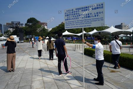 Visitors are asked to wait as rehearsal for the Peace Memorial Ceremony are held at Hiroshima Peace Memorial Museum in Hiroshima, western Japan