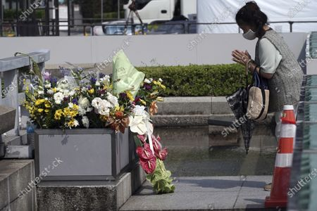 Visitor prays at the cenotaph for the atomic bombing victims near Hiroshima Peace Memorial Museum in Hiroshima, western Japan