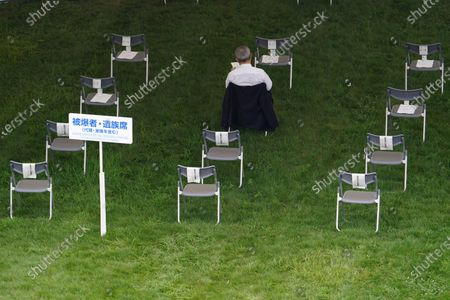 Participant sits as chairs are placed at intervals for social distance to prevent the spread of coronavirus before the ceremony to mark the 75th anniversary of the bombing at the Hiroshima Peace Memorial Park in Hiroshima, western Japan