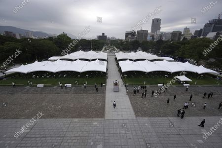 Participant gather at the Hiroshima Peace Memorial Park before the ceremony to mark the 75th anniversary of the bombing, in Hiroshima, western Japan
