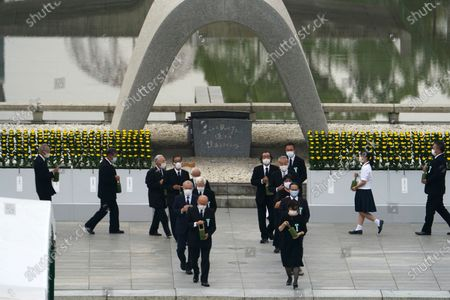 Participants gather at Hiroshima Memorial Cenotaph during the ceremony to mark the 75th anniversary of the bombing at the Hiroshima Peace Memorial Park in Hiroshima, western Japan