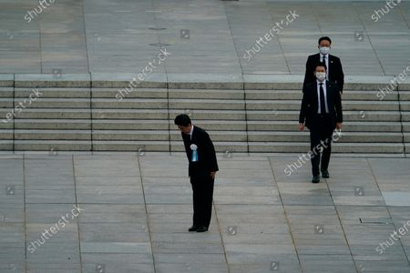 Japanese Prime Minister Shinzo Abe bows to the families of the victims during a ceremony to mark the 75th anniversary of the bombing at the Hiroshima Peace Memorial Park, in Hiroshima, western Japan