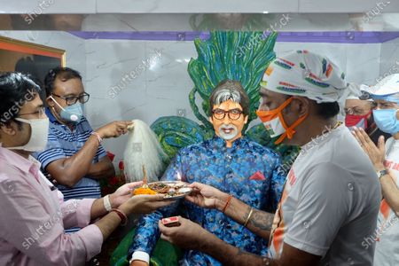 The fans of Bollywood actor Amitabh Bachchan are offering prayer and doing 'Mangal Kamba Yogya at Amitabh Bachchan's Temple as they celebrate second birthday anniversary of Amitabh Bachchan as they expect the release of the veteran actor from the hospital after fighting with Covid -19.
