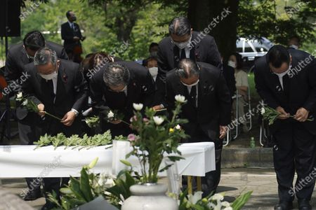 South Korean residents living in Japan offer flowers and pray during a memorial service for Korean atomic bomb victims in front of Monument to Korean Victims and Survivors at Hiroshima Peace Memorial Park in Hiroshima, western Japan, . Hiroshima marks the 75th anniversary of the world's first atomic bombing on Aug. 6