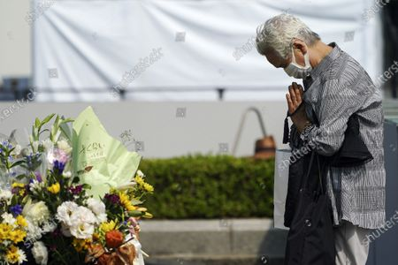 Visitor prays at the cenotaph for the atomic bombing victims near Hiroshima Peace Memorial Museum in Hiroshima, western Japan . The city of Hiroshima on Thursday, Aug. 6 marks the 75th anniversary of the U.S. atomic bombing