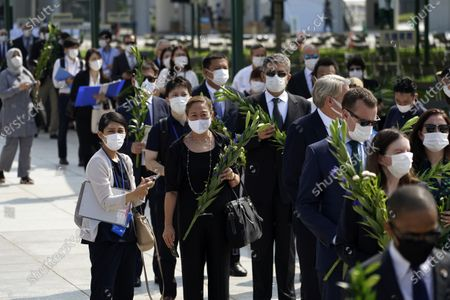 Diplomats to Japan line up to offer flowers to the cenotaph for the atomic bombing victims, near the Hiroshima Peace Memorial Museum in Hiroshima, western Japan. On Aug. 6th, Japan will mark the 75th anniversary of the atomic bombing on Hiroshima