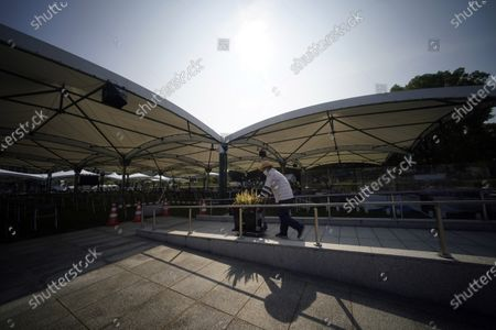 Worker brings decorative flowers to the anniversary venue, near the Hiroshima Peace Memorial Museum in Hiroshima, western Japan. On Aug. 6th, Japan will mark the 75th anniversary of the atomic bombing on Hiroshima