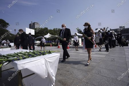Diplomats to Japan offer flowers to the cenotaph for the atomic bombing victims, near the Hiroshima Peace Memorial Museum in Hiroshima, western Japan. On Aug. 6th, Japan will mark the 75th anniversary of the atomic bombing on Hiroshima