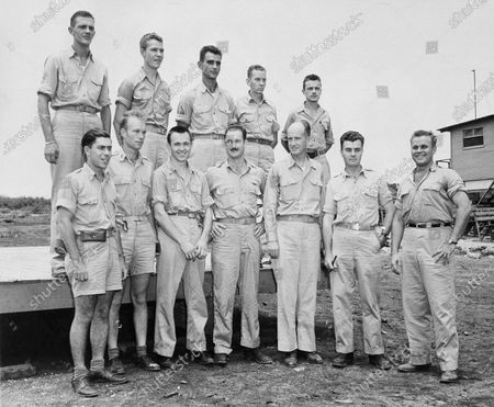 Crew members of the Enola Gray, B-29 Superfortress from which the first atomic bomb was dropped on Hiroshima, western Japan. From left to right are, front row: 1st Lt. Jacob Beser, 2nd Lt. Norris R. Jeppson Capt. Theodore J. Van Kirk; Maj. Thomas W. Ferebee, Capt. William S. Parsons, Col. Paul W. Tibbets Jr., Capt. Robert A. Lewis. Back row, left to right: Sgt. Robert R. Shumard, Pfc., Richard H. Nelson, Sgt. Joe A. Stiborn, Sgt. Wyatt E. Duzenbury, Sgt. George R. Caron