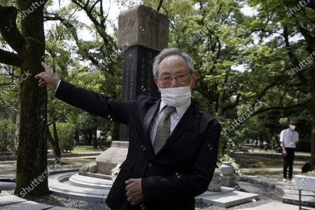 Lee Jong-keun, an atomic bomb survivor, speaks after a memorial service for Korean atomic bomb victims in front of Monument to Korean Victims and Survivors at Hiroshima Peace Memorial Park in Hiroshima, western Japan . Lee kept his secret as an atomic bombing survivor for nearly 70 years, not even telling his wife, always fearing people might notice the burn marks on the face. But today Lee, a second-generation Korean born in Japan, is training young people to tell survivors' stories. He also wants them to learn about the difficulty that Koreans have faced in Japan