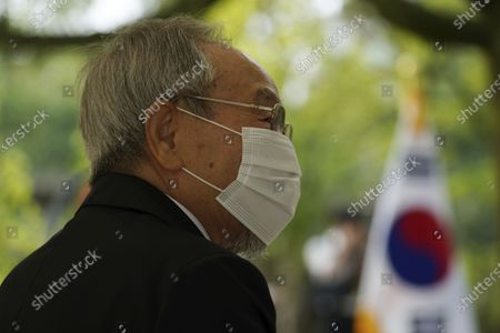 Lee Jong-keun attends a memorial service for Korean atomic bomb victims in front of the Monument to Korean Victims and Survivors at Hiroshima Peace Memorial Park in Hiroshima, western Japan, . Lee kept his secret as an atomic bombing survivor for nearly 70 years, not even telling his wife, always fearing people might notice the burn marks on the face. But today Lee, a second-generation Korean born in Japan, is training young people to tell survivors' stories. He also wants them to learn about the difficulty that Koreans have faced in Japan