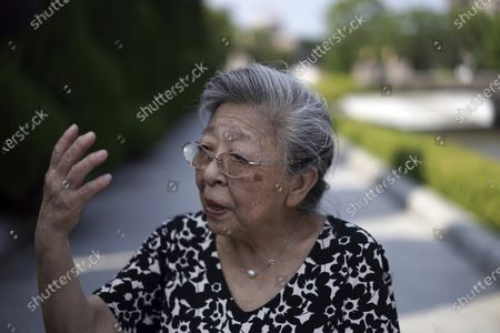 """Koko Kondo speaks during an interview with The Associated Press in front of the cenotaph for the atomic bombing victims near Hiroshima Peace Memorial Museum in Hiroshima, western Japan . Kondo was determined to find the person who dropped the atomic bomb on Hiroshima, western Japan, the person that caused the suffering and the terrible facial burns of the girls at her father's church - and then square off and punch them in the face. Ten-year-old Kondo appeared on an American TV show called """"This is Your Life"""" that was featuring her father, Rev. Kiyoshi Tanimoto, one of six survivors profiled in John Hersey's book """"Hiroshima."""" Kondo stared in hatred at another guest: Capt. Robert Lewis, co-pilot of B-29 bomber Enola Gay that dropped the bomb"""