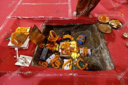 Offerings lie at the site of a groundbreaking ceremony of a temple dedicated to the Hindu god Ram in Ayodhya, India, . Despite the coronavirus restricting a large crowd, Hindus rejoiced as Indian Prime Minister Narendra Modi broke ground Wednesday on a long-awaited temple of their most revered god Ram at the site of a demolished 16th century mosque. Modi offered prayers to nine stone blocks with lord Ram inscribed on it amid chanting of Hindu religious hymns to symbolize the start of construction of the temple, which is expected to take three and a half years